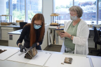 Salt Lake Temple: Church History employees inspecting artifacts